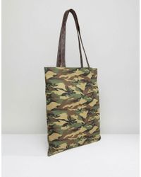 ASOS Green Tote Bag In Camo Print With Faux Leather Straps