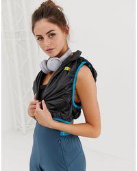 Bolso intercambiable para correr con chaleco plegable con capucha ASOS 4505 de color Blue