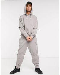 Felpa oversize grigia con cappuccio, maniche arricciate e tasca cargo di ASOS in Gray da Uomo