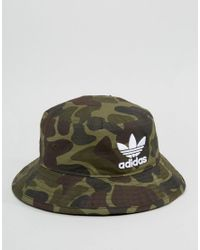 Lyst - adidas Originals Bucket Hat In Camo Bk7618 in Green for Men 324bb144508