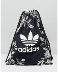 308e0d7ada0e adidas Originals. Women s Black Originals Farm Print Drawstring Backpack In  Monochrome Floral