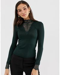 Top a maniche lunghe con collo alto di Y.A.S in Green