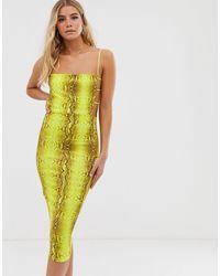 Robe moulante mi-longue effet serpent à liens sur les côtés - Fluo PRETTYLITTLETHING en coloris Yellow