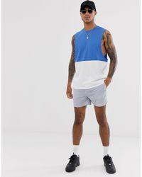 T-shirt bio décontracté sans manches à emmanchures larges avec empiècement contrastant ASOS pour homme en coloris White