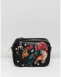 3869a1ca9534 Liquorish Embroidered Across Body Bag in Black - Lyst