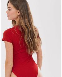 Body girocollo rosso acceso a coste di New Look in Red