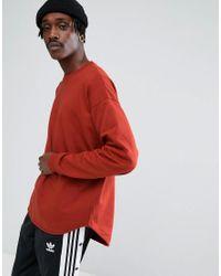ASOS Asos Oversized Longline Sweatshirt With Curved Hem In Red for men