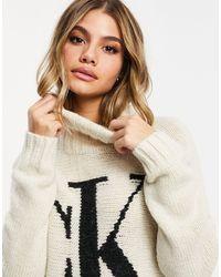 Мягкий Трикотажный Джемпер Кремового Цвета С Отворачивающимся Воротом И Логотипом Спереди -кремовый Calvin Klein, цвет: Natural