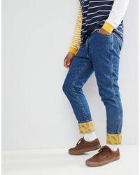 Wrangler Blue & Yellow Slim Tapered Jeans for men