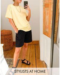 Camiseta holgada con mangas remangadas en color limón ASOS de color Yellow