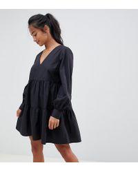 capture vente chaude en ligne 60% de réduction Robe babydoll courte tage en coton manches longues femme de coloris noir