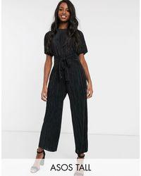 ASOS DESIGN Tall - Tuta jumpsuit plissé allacciata sul davanti con gonna a pantalone di ASOS in Black