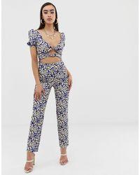 Lioness Blue – Schulterfreier Jumpsuit mit doppelter Schnürung und geometrischem Print
