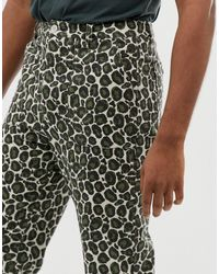 Pantalones con estampado animal desgastado Fatigue ASOS de hombre de color Multicolor