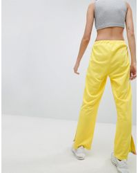 ASOS Yellow Trackpants With Rainbow Side Stripe And Vent Detail