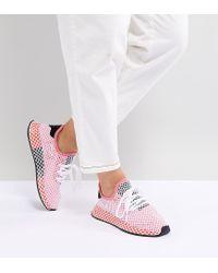 adidas originali deerupt runner scarpe in rosso e rosa in rosa lyst