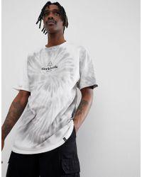 Camiseta con efecto teido anudado con logo en blanco de Huf de hombre de color White