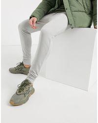 Joggers skinny grigio mélange con fondo largo a coste di ASOS in Multicolor da Uomo