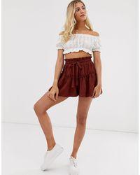 Falda pantalón con vuelo y bordado ASOS de color Brown