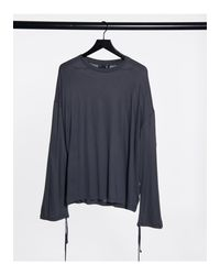 Camiseta extragrande en lavado negro con manga larga y detalle ASOS de hombre de color Black