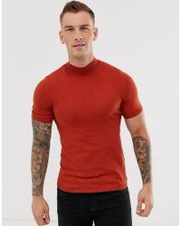 Camiseta de punto de algodón con cuello alto en naranja quemado ASOS de hombre de color Red