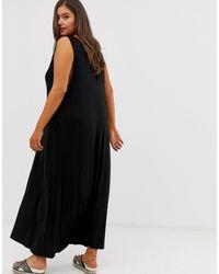 ASOS DESIGN Curve - Robe longue trapèze à décolleté plongeant ASOS en coloris Black