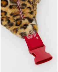 Riñonera extragrande con tira del loso y estampado de leopardo Levi's de color Red