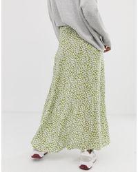 Jupe longue boutonnée sur le devant avec imprimé à fleurs vert ASOS en coloris Green