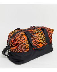 Corrine - Sac de sport motif tigre Skinnydip London en coloris Orange