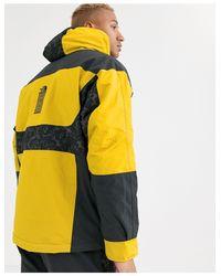 """94 Rage Synth - Giacca impermeabile isolante giallo/grigio leopardato con stampa """"Rage"""" di The North Face in Yellow"""