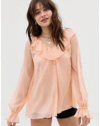Blusa trasparente con maniche lunghe, volant e canotta di ASOS in Pink