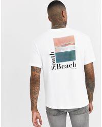 T-shirt oversize avec imprimé South Beach au dos Bershka pour homme en coloris White