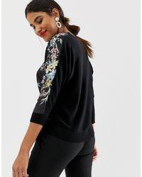 Maglione a portafoglio con stampa a fiori di Oasis in Black