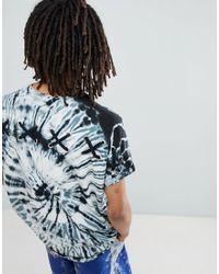 T-shirt lunga oversize con maniche con risvolto, occhielli e incroci sul retro e lavaggio tie-dye a spirale di ASOS in Gray da Uomo