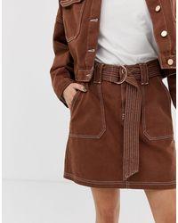 Mini-jupe à surpiqûres contratantes River Island en coloris Brown