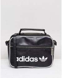 e8426207bfeb Lyst - adidas Originals Originals Vintage Mini Airliner Bag In Black ...