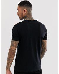 Camiseta relax con estampado ASOS de hombre de color Black