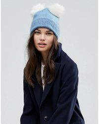 93ca950d7727aa ASOS Fluffy Beanie With Double Faux Fur Pom in Blue - Lyst