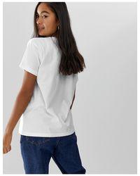 T-shirt à imprimé signes du zodiaque taureau, gémeaux, cancer, lion ASOS en coloris White