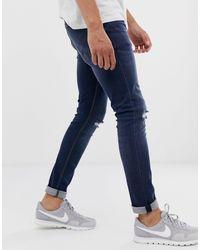 Jean skinny avec déchirures aux genoux - Délavage foncé ASOS pour homme en coloris Blue