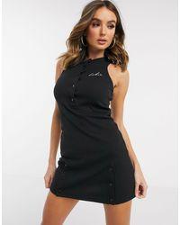 Vestito a fascia attillato nero a coste di The Couture Club in Black