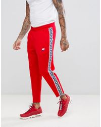 8a6e9a01f11e2 Nike Joggers With Taped Side Stripe In Red Aj2297-657 in Red for Men ...