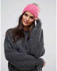 Bonnet avec pompon en fausse fourrure Vero Moda en coloris Pink