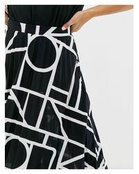 Jupe mi-longue plissée imprimé abstrait ASOS en coloris Black