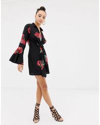 Robe courte évasée style smoking - Noir fleuri Missguided en coloris Black