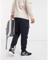 Swoosh On Tour Pack - Jogger cargo avec chevilles resserrées Nike pour homme en coloris Black