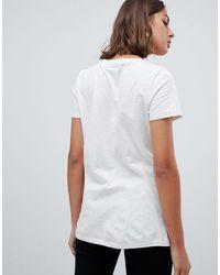 Moves By - T-shirt avec petite inscription Minimum en coloris White