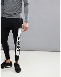 Joggers tapered ajustados de punto en negro 146387-0904 Asics de hombre de color Black