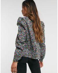 Blusa con maniche a sbuffo e stampa a fiori di Vero Moda in Multicolor