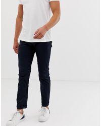Pantalones de corte slim en azul marino Gaberdine J13 Armani Exchange de hombre de color Blue